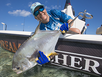 Flats fishing, anglers hold up a nice permit.